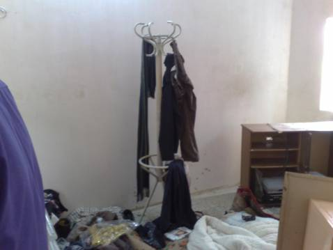 Clothing and personal possessions strewn about the house.