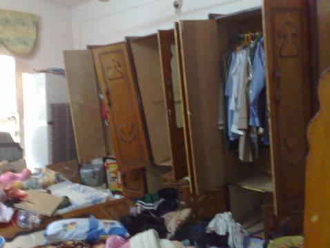 Damage to wardrobes with clothing strewn about the bedroom after an Iraqi special forces raid in northeast Baghdad on Friday.