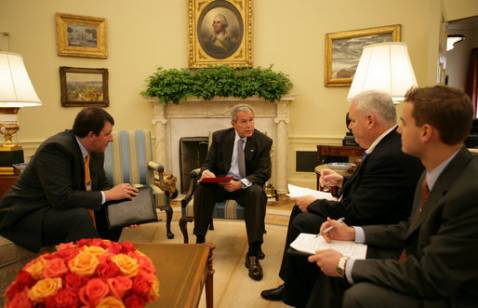 President George W. Bush goes over a draft of tonight's address to the nation with members of the White House speechwriting staff Thursday, Sept. 13, 2007, in the Oval Office. With him, from left, are: Marc Thiessen, Bill McGurn and Christopher Michel. Wh