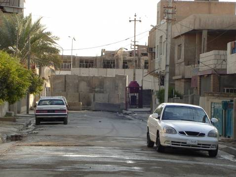 An empty street and a concrete security barrier are seen in Baghdad's southern Dora district, in the Hay al-Iskan al-Sha'bi area. January 2008.