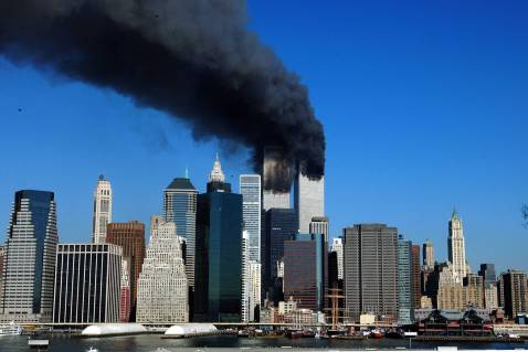 NEW YORK, UNITED STATES: The twin towers of the World Trade Center billow smoke after hijacked airliners crashed into them early 11 September, 2001.