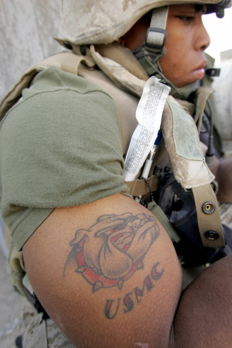 Marine Shows Off His Tattoo in AL-Qaim