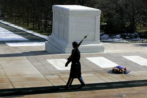 A member of the US Honor Guard crosses in front of the Tomb of the Unknown Soldier in Arlington National Cemetery.