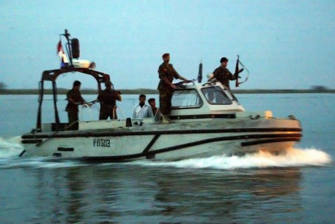 Basra, IRAQ: Iraqi coast guards patrol the waters off the Iranian Bou Chahr port in southern Iraq late 23 March 2007.