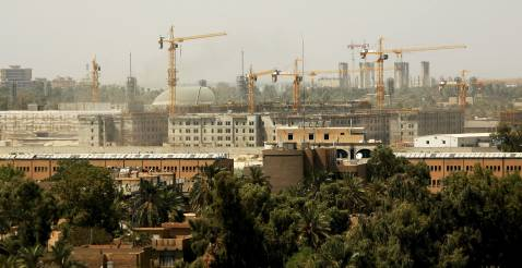 BAGHDAD, IRAQ - AUGUST 31: Cranes litter the skyline as construction workers continue work on the new United States Embassy compound in Baghdad's fortified Green Zone on August 31, 2006 in Baghdad, Iraq.