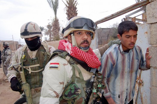 Kirkuk, IRAQ: Iraqi soldiers arrest a youth during an Iraqi and US military operation at outskirts of the northern oil rich city of Kirkuk, 14 February 2007. Fifteen suspects were arrested during the operation.