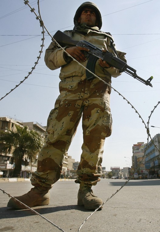 An Iraqi soldier mans a checkpoint in Baghdad on Thursday.
