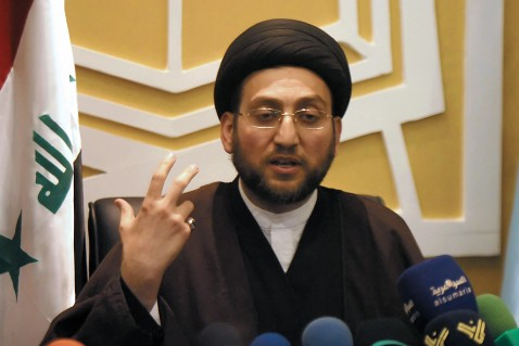 NAJAF, IRAQ: Iraqi cleric Ammar al-Hakim gestures as he speaks during a press conference in the holy city of Najaf, central Iraq, 24 February 2007.