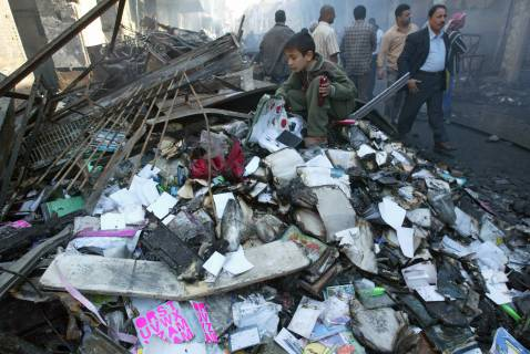 March 6, 2007: Piles of burned books on Mutanabbi Street.