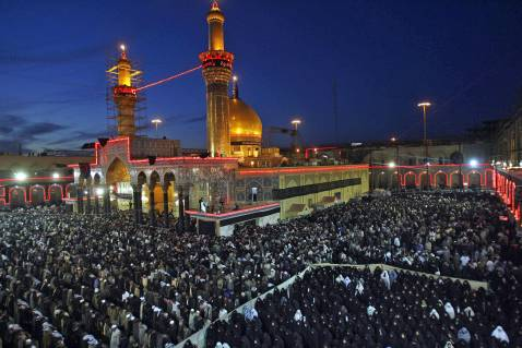 Shi'a faithful pray at the shrine of Husayn in Karbala during the Ashura pligrimage in March 2007.