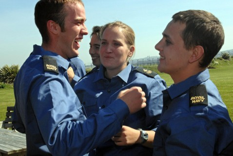 CHIVENOR, UNITED KINGDOM: A handout photograph dated 05 April 2007, shows British Leading Seaman Faye Turney (2nd R) celebrating with Arthur Batchelor (R) and Andrew Henderson (L) at RAF Chivenor in Devon in south-west England.