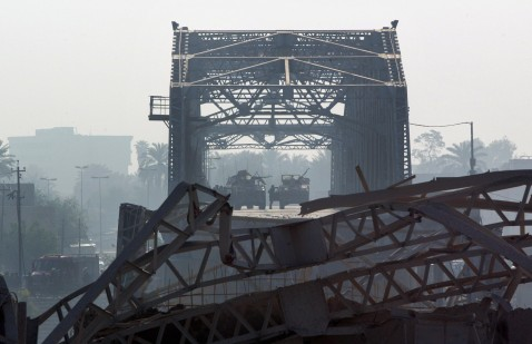 Baghdad, IRAQ: There have been 4 major bridges destroyed so far in Baghdad. Here, US soldiers secure the area at the entrance of Baghdad's collapsed al-Sarrafiyah bridge where a suicide bomber blew himself up in a truck in April 2007.