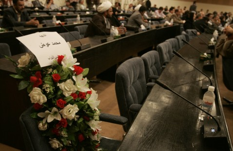 BAGHDAD, IRAQ - APRIL 13: Flowers rest on the seat of Sunni lawmaker Mohammed Awdh during a defiant special session of Parliament April 13, 2007 in Baghdad, Iraq.