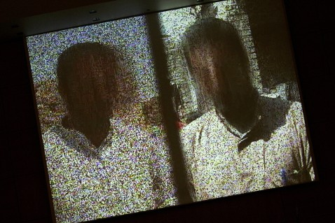 Geneva, SWITZERLAND: Two Iraqi refugees appear with their faces blurred while delivering testimonies in video shown at the opening of a two-day United Nations conference, 17 April 2007 at the UN Office in Geneva.