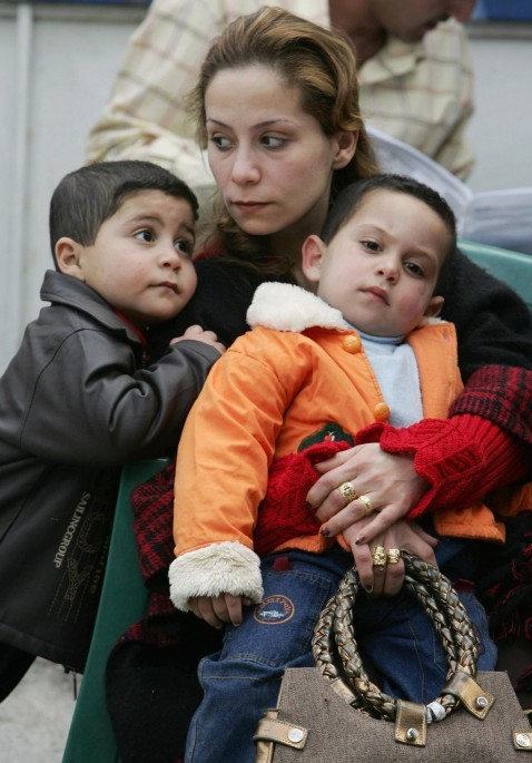 Khitam Munir and her two sons (3 and 4 years-old) wait their turn to register at the United Nations High Commission for Refugees (UNHCR) registration centre in Duma, 15 km north of the Syrian capital Damascus, 23 April 2007.
