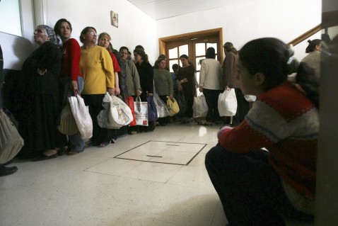 JARAMANA, SYRIA - APRIL 24: Iraqi refugees wait for a meal distributed by Ibrahim al-Khalil church April 24, 2007 in Jaramana, near Damascus, Syria.