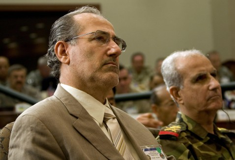 National Security Advisor for Iraq Dr. Muwafaq Al-Rubaie (L) and Lt General Yacoob Abu-Khudur, Iraq Joint Forces Deputy Chief of Staff for Operations, listen as US President George W. Bush makes remarks at the US Central Command Coalition Conference in Ta