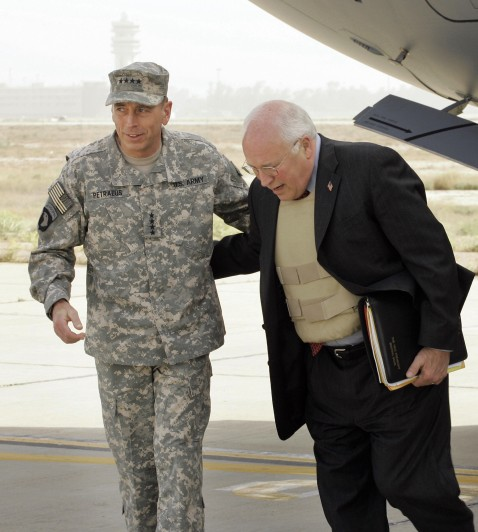 US Vice President Dick Cheney is greeted by Gen. David Petraeu, commander of US forces in Iraq, as he arrives at Baghdad International Airport on a surprise visit in Baghdad today.