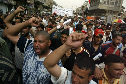Iraqi supporters of Shi'a cleric Muqtada Al-Sadr shout slogans against the visit of US Vice President Dick Cheney to Iraq on May 9, 2007 in the Kadhimiya district of Baghdad, Iraq. (Photo by Getty Images)