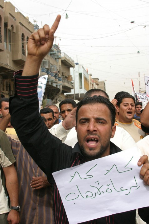 Sadrist supporters rally against the visit of US Vice President Dick Cheney to Iraq on May 9, 2007 in Kadhimiya. The sign in the foreground reads No to the sponsors of terrorism.