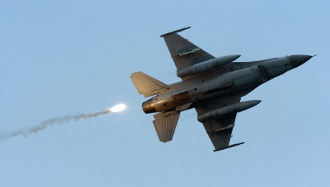 An F-16 fighter jet releasing flares