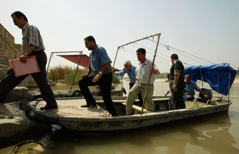 BAGHDAD, IRAQ - MAY 24: Iraqis alight from a boat after crossing the Tigris River on May 24, 2007 in Baghdad, Iraq.