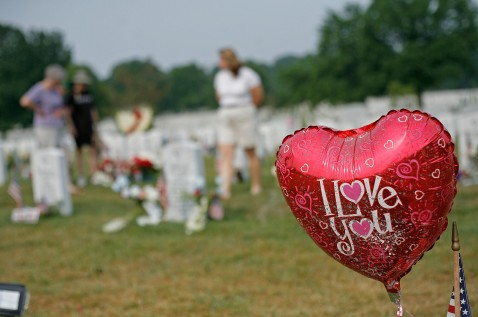 ARLINGTON, VA - MAY 28: A ballon that says I Love You is shown attached to a gravestone at section 60 on Memorial Day at Arlington National Cemetery May 28, 2007 in Arlington, Virginia.