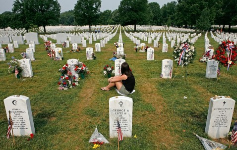 ARLINGTON, VA - MAY 28: A women sits at a gravesite in section 60 on Memorial Day at Arlington National Cemetery May 28, 2007 in Arlington, Virginia.