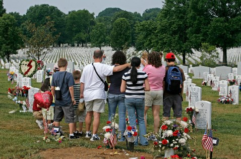 ARLINGTON, VA - MAY 28: Visitors pay their respects at gravesites in section 60 on Memorial Day at Arlington National Cemetery May 28, 2007 in Arlington, Virginia.