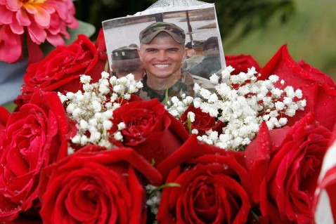 ARLINGTON - MAY 28: A picture of a fallen soldier addorned with roses sits on a gravesite on Memorial Day at section 60 at Arlington Cemetery May 28, 2007 in Arlington, Virginia.
