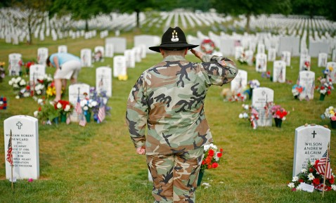 ARLINGTON - MAY 28: Military veteran Benjamin Troy salutes at a gravesite in section 60 on Memorial Day at Arlington National Cemetery May 28, 2007 in Arlington, Virginia.