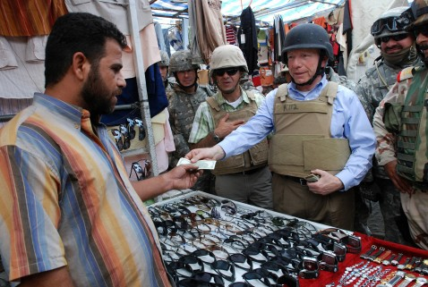 Baghdad, IRAQ: A picture released by the US army 31 May 2007 shows Senator Joe Lieberman paying an Iraqi vendor for a pair of sunglasses at a market in the New Baghdad neighborhood, 30 May.
