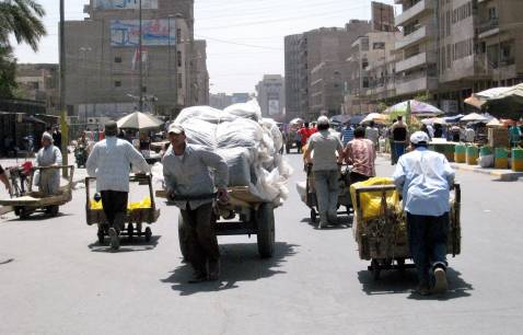 Baghdad, IRAQ: Iraqis use carts to transport their merchandise in Baghdad's Al-Shorjah market, 09 June 2007.