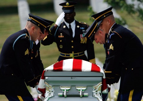 An honor guard carries casket of Army Sgt. 1st Class Greg Lamonte Sutton during a burial ceremony with military honors. Sutton died June 6 after his vehicle struck an IED in Baghdad. Sutton, who was originally from Spring Lake, N.C., reportedly volunteered to go to Iraq so that a friend and co-worker could retire.