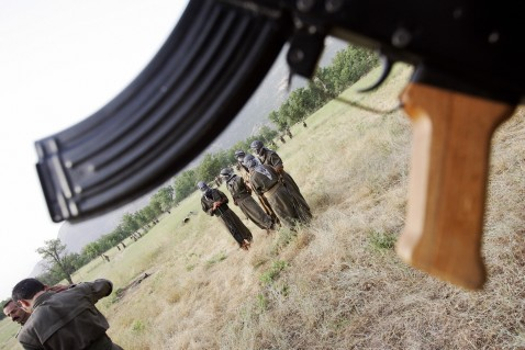 Dohuk, IRAQ: PKK fighters attend a training session at the Mahsun Korkmaz Academy early in the morning 20 June 2007 at Amedia area in Northern Iraq, 10 km near Turkish border.