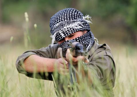 Dohuk, IRAQ: A PKK fighter takes position with his rifle during a training session at the Mahsun Korkmaz Academy early in the morning 20 June 2007 at Amedia area in Northern Iraq, 10 km near Turkish border.