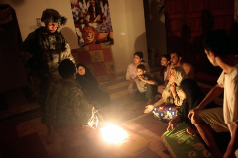 BAGHDAD, IRAQ - JUNE 27: Paratroopers and translators in the 82nd Airborne Division's 1st Battalion, 325th Infantry Regiment talk to a family in the supposed house of a suspected Shia terrorist in the pre-dawn hours of June 27, 2007 in the Hurriyah neighb