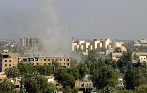 Baghdad, IRAQ: Smoke billows from the site where a mortar round fell on the fortified Green Zone in Baghdad, 28 June 2007. A rush-hour car bomb attack at a Baghdad bus stop killed today 21 people and wounded dozens, hours after the British military lost t