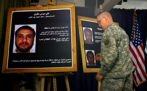BAGHDAD, IRAQ - JULY 02: A US solider shows a picture of Ali Mussa Daqduq on July 2, 2007, who US officials say provided the link between Iran and the January 20 attack on the Karbala Joint Coordination Center.
