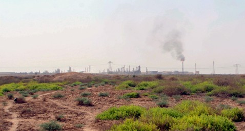 Basra, IRAQ: A general view shows an oil refinery in the southern Iraqi city of Basra, 03 July 2007.
