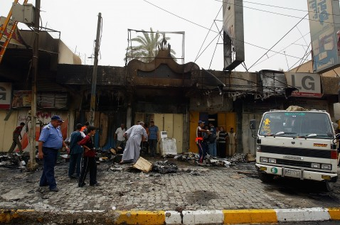 BAGHDAD, IRAQ - JULY 8: Iraqi shopkeepers move their goods damaged in a car bomb explosion on July 8, 2007 in Karrada district in Baghdad, Iraq. Two car bombs exploded in Baghdad killing at least 2 and injuring five others.