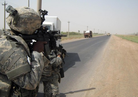 A US soldier takes a combat position as he approaches a truck during a patrol at an area in the Iraqi Tamim Province, 07 July 2007.