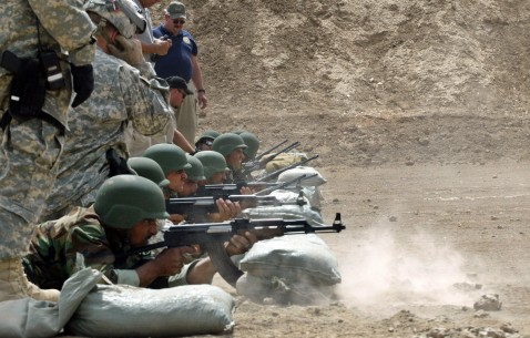 Hilla, IRAQ: US soldiers observe Iraqi police cadets shoot as they train at a firing range in a training base in the Iraqi town of Hilla, central Iraq, 09 July 2007.