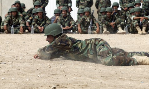 Hilla, IRAQ: Iraqi police cadets train at a military base in the Iraqi town of Hilla, central Iraq, 10 July 2007.