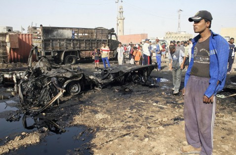 Baghdad, IRAQ: Iraqis inspect the wreckage of a truck which was allegedly targeted by a military air strike on the outskirts of Baghdad's impoverished district of Sadr City according to local witnesses, 11 July 2007.