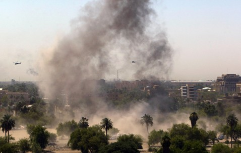 Baghdad, IRAQ: US helicopters fly over smoke billowing from the site of a car bomb that exploded in a parking lot nearby the Green Zone area in central Baghdad, 17 July 2007.