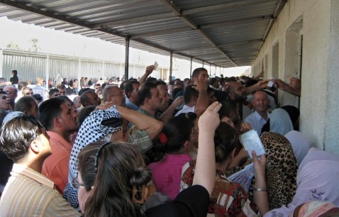 Baghdad, IRAQ: Crowds of Iraqis gather in front of Iraq's Passports Department to have their travel documents issued in Baghdad, 21 July 2007.