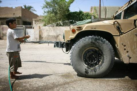 Iraqi boy with American Humvee, Ba'quba, July 2007.