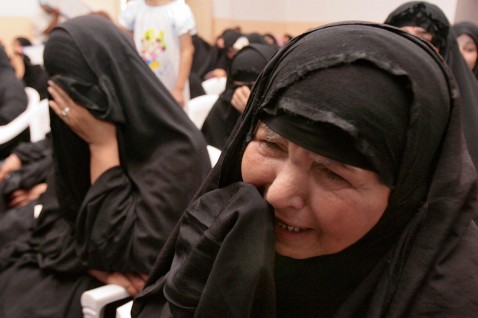 Iraqi women cry as amateur actors perform a play called Rise up to the sky, produced to commemorate the death of Shiite fighters in the August 2004 battle against US and Iraqi forces.