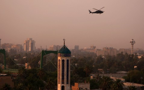 BAGHDAD, IRAQ - AUGUST 06: A U.S. military helicopter flies at dusk August 6, 2007 over Baghdad, Iraq. Twenty-eight people, including 19 children, were killed today when a suicide bomber detonated his bomb-laden truck in a residential area in the northern